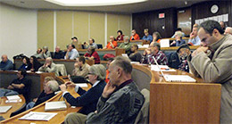 the audience watches as the speaker gives a presentation in Bowl 1 of Robertson Hall