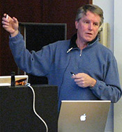 Bill Achuff, freelance photojournalist and photographer (photo from the November 10, 2009 meeting.)